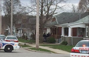 London police surround a home on Madison Ave. Photo by Ashton Patis.