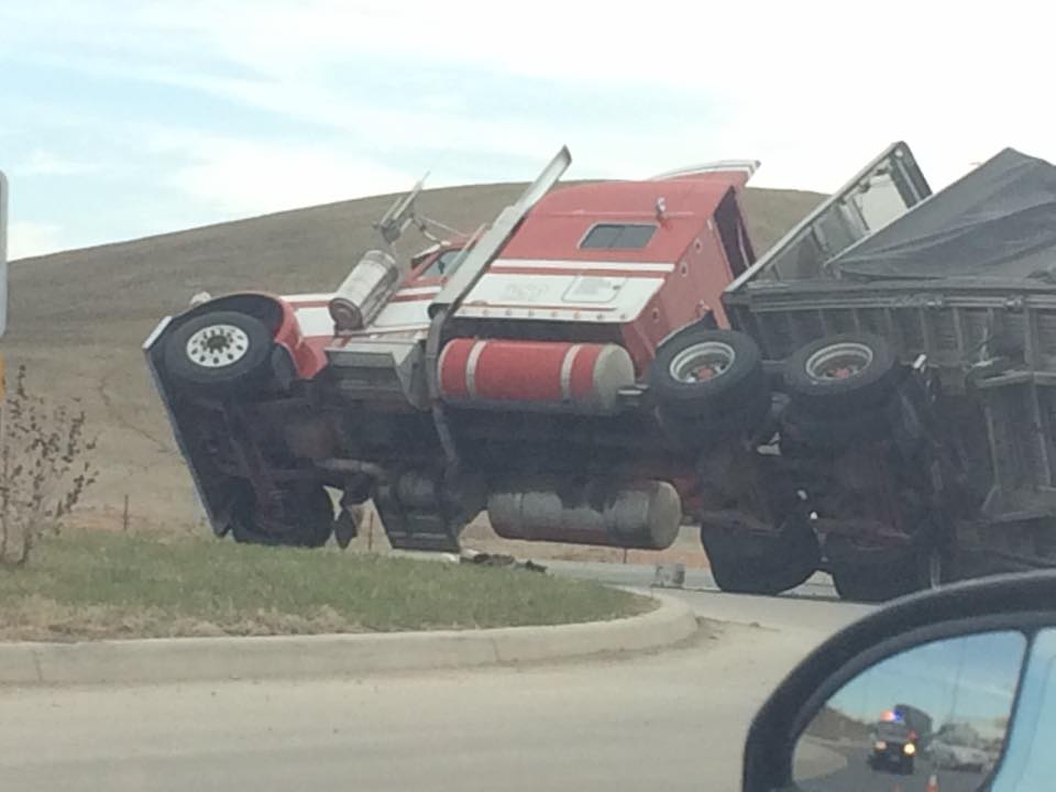 A tractor trailer flips over at the roundabout at Hwy. 3 and Hwy. 401, April 14, 2015. (Photo courtesy of Trish Longson)