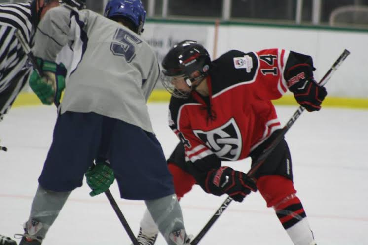 Lucas Vanroboys (red and black) lines up to take a faceoff. (Photo courtesy of Gina Vanroboys)