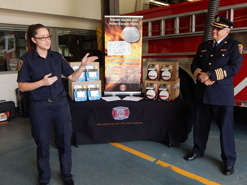 Public educator Ashley Scott and Asst. Fire Chief Bob Davidson introduce awareness campaign May 27, 2015 (Photo by Simon Crouch)