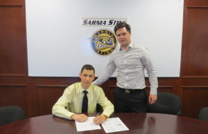 Sasha Chmelevski  signs Standard Player Agreement with the Sting. May 21, 2015. photo provided by Sarnia Sting.