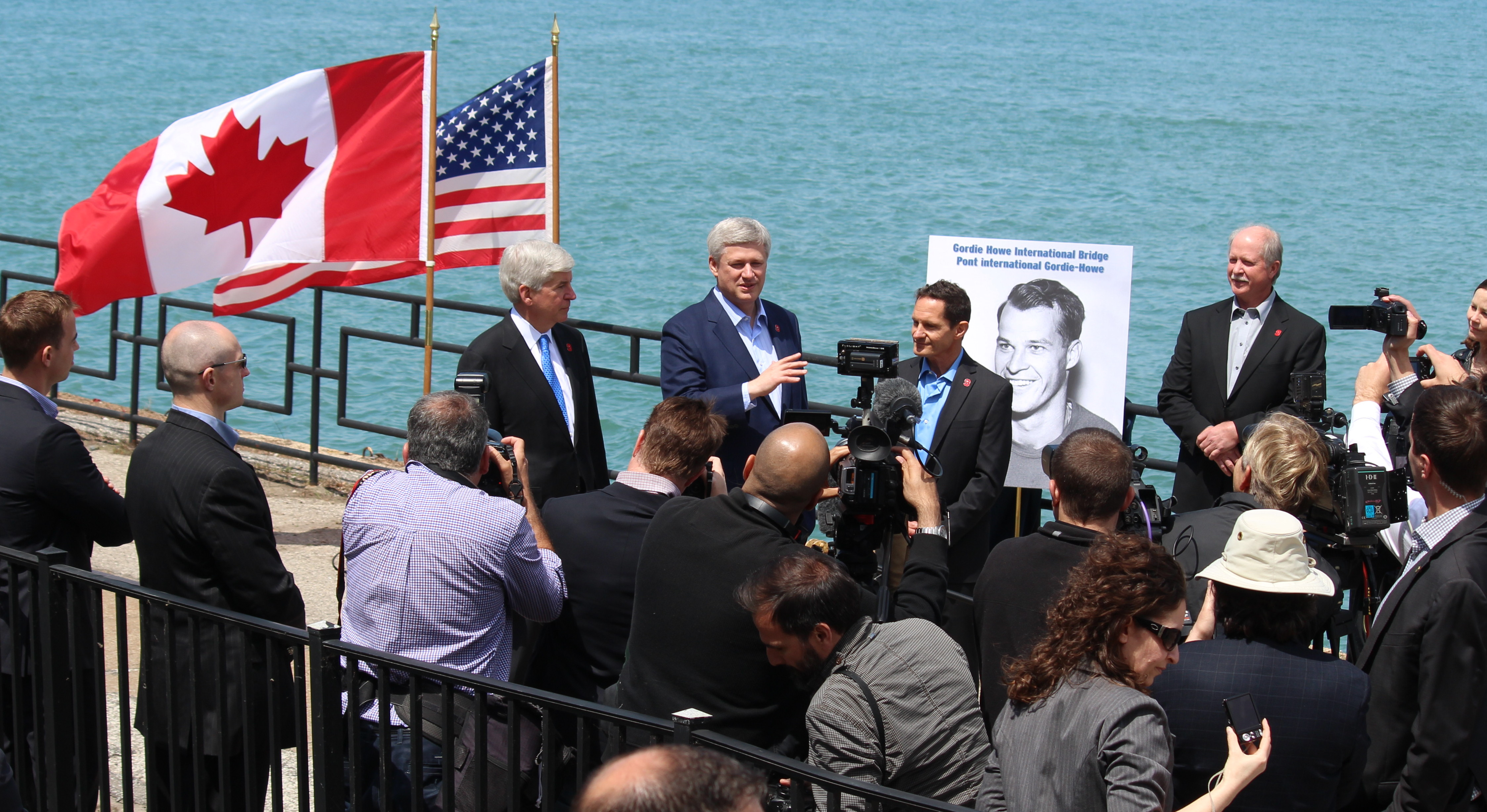 Prime Minister Stephen Harper, Michigan Gov. Rick Snyder and members of the Howe family unveil the name of Windsor-Detroit's new bridge, May 14, 2015. (Photo by Mike Vlasveld)