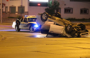 One vehicle flipped following a collision at the intersection of Howard Ave. and Tecumseh Rd. E, May 19, 2015. (Photo by Jason Viau)