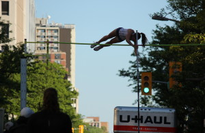 Athletes compete in a pole vaulting competition on Ouellette Ave., May 22, 2015. (Photo by Jason Viau)