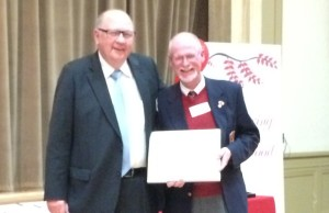 Wayne Gladstone (right) Canadian Blood Services board member with George Sims (Chatham) who reached 100 donations in 2014 (Photo courtesy of Chris McCleod)
