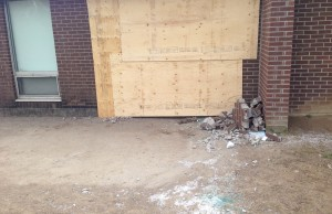 Damage boarded up on the side of Scared Heart in Wingham after a car crashed into the school. (photo by Ryan Brandt)