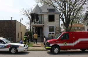 Windsor police continue to investigate at 579 Church St. after an arson, May 6, 2015. (Photo by Mike Vlasveld)
