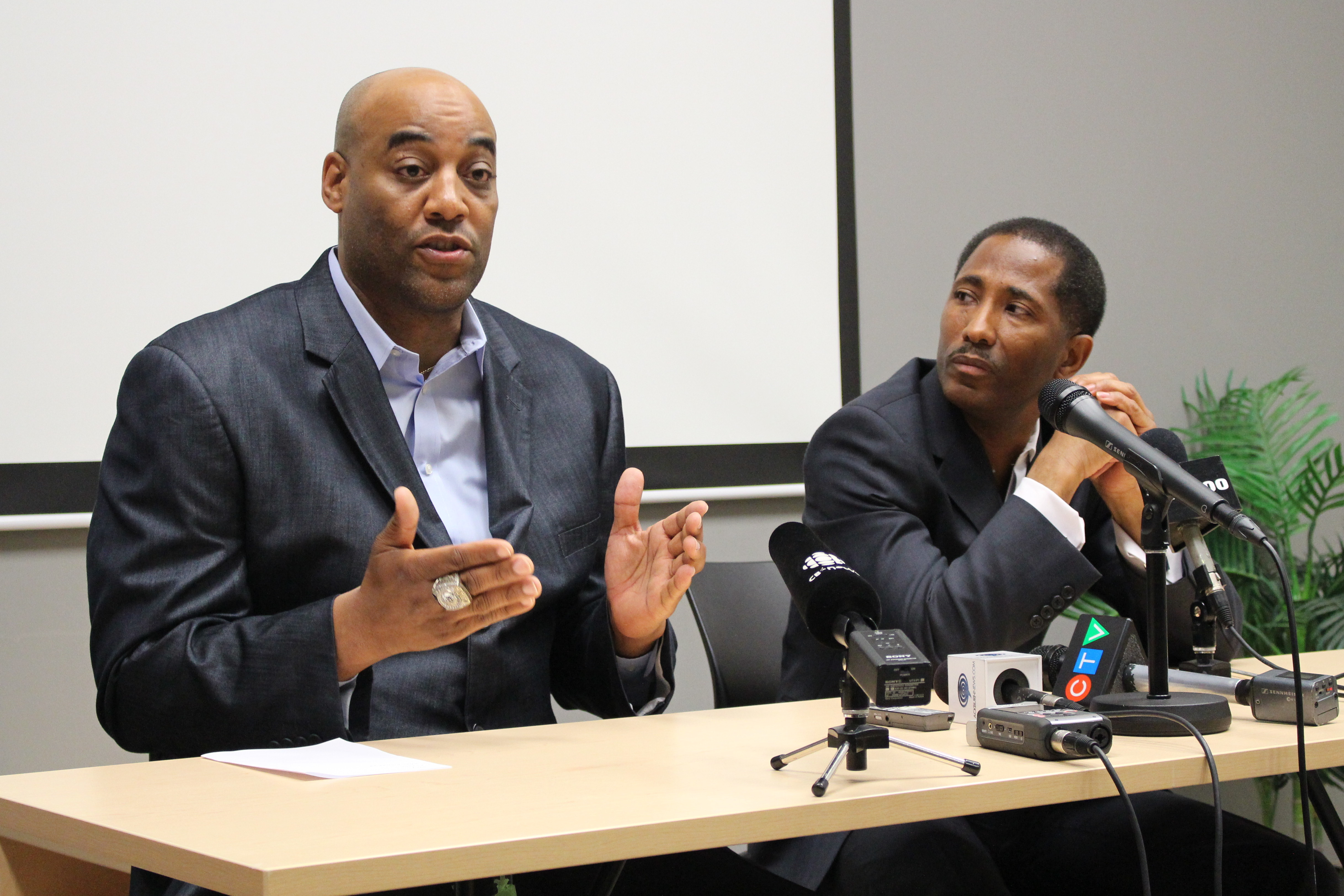 Windsor Express Head Coach Bill Jones (left) and Owner Dartis Willis speak with media at Windsor's Downtown Business Accelerator, May 8, 2015. (Photo by Mike Vlasveld)