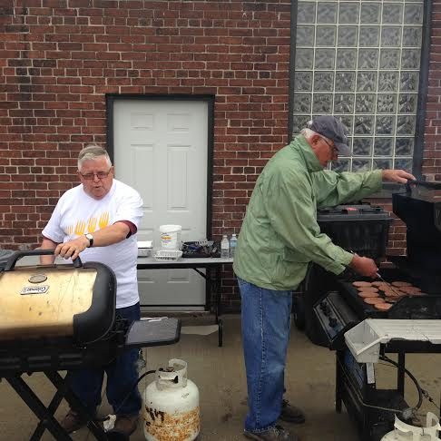 Len Shortt (left) and Jean Belanger both volunteers at Outreach For Hunger help out at a barbecue to raise awareness of hunger issues May 5 2015 (Photo by Simon Crouch)