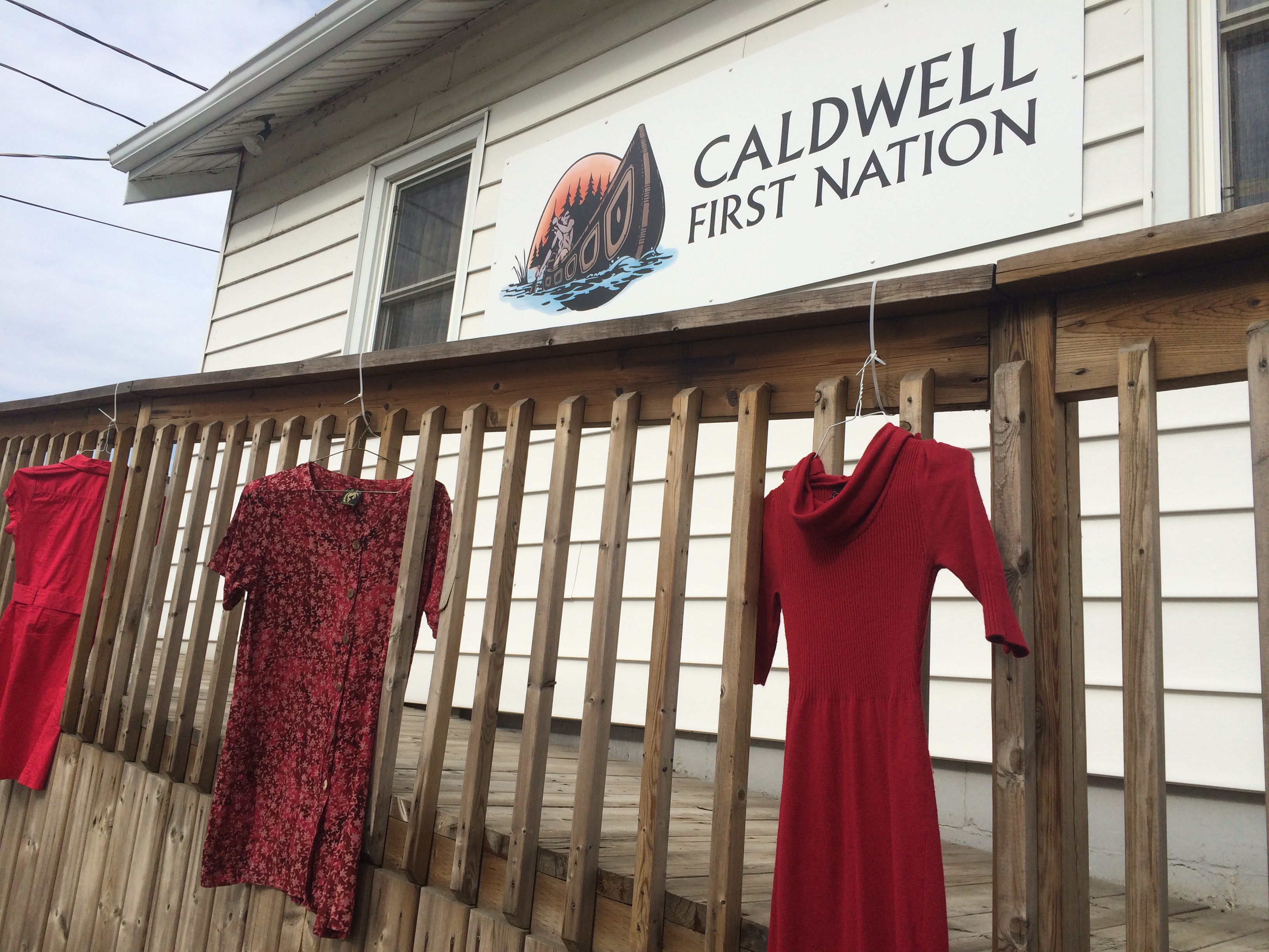 Red dresses hang outside the Caldwell First Nation office in Leamington on May 20, 2015. (Photo by Ricardo Veneza)