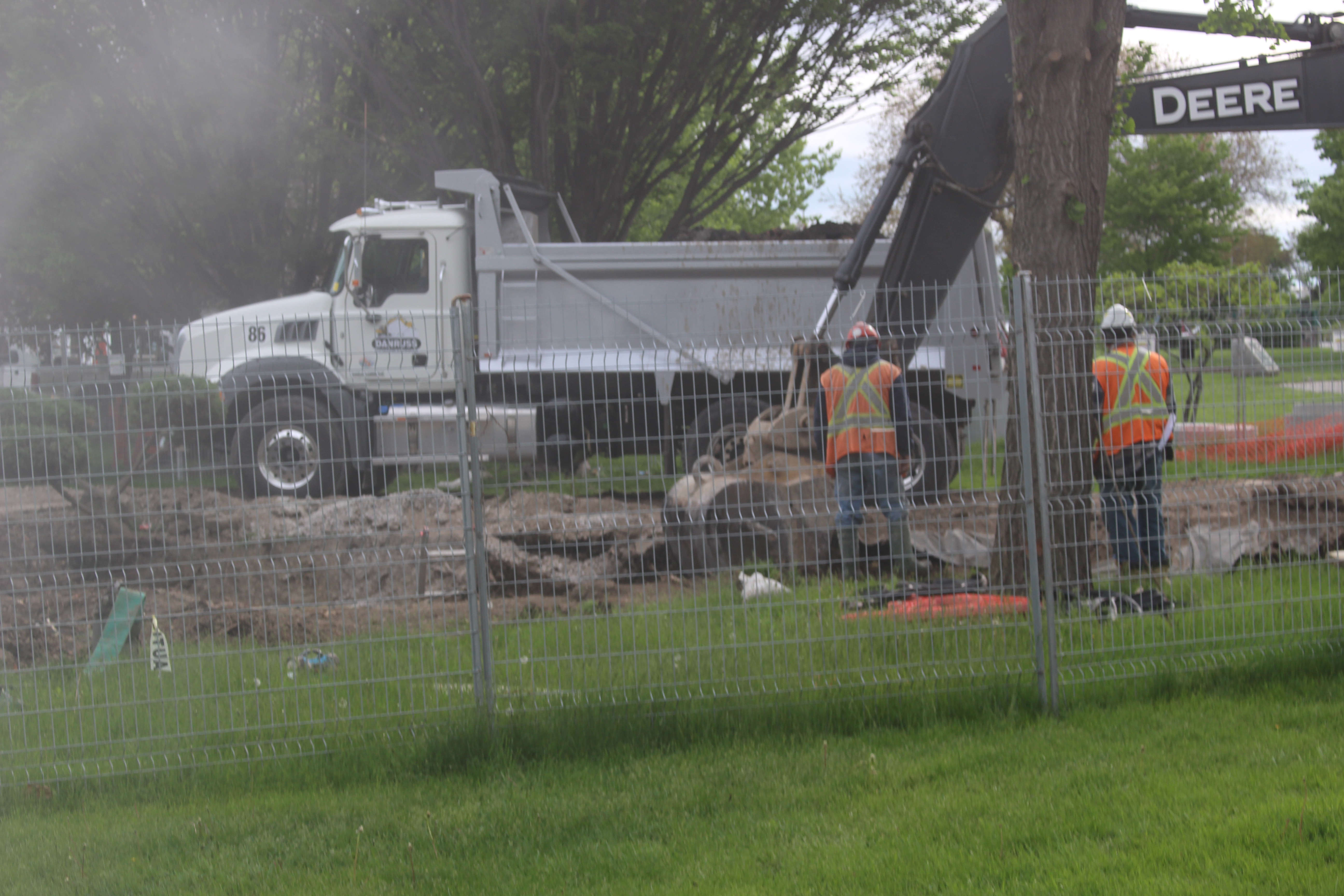 Construction workers dig where a sink hole opened up in Dieppe Park in Windsor, May 20, 2015. (Photo by Adelle Loiselle)