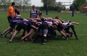 F.E Madill (Purple) and Stratford Northwestern scrum during the Huron-Perth senior boys rugby title game. (by Ryan Brandt)