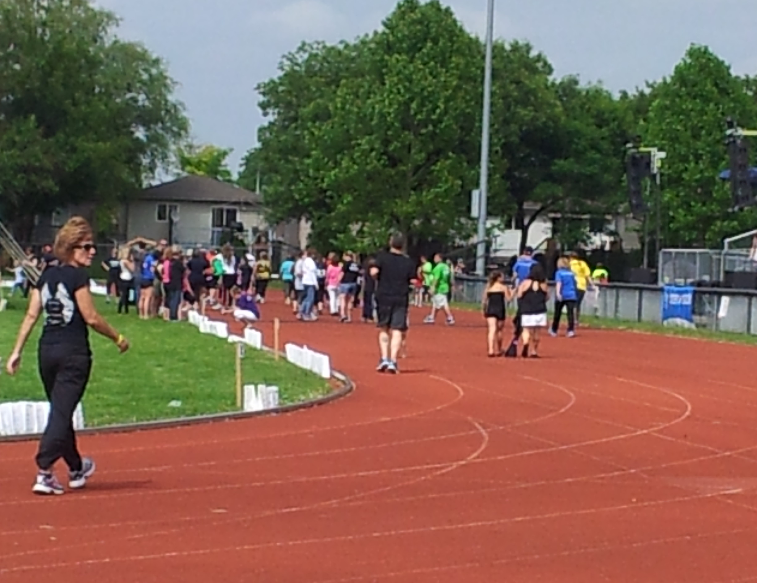 Local residents participate in Relay for Life 2015 at Chatham Kent Secondary School, June 13, 2015. (Photo by the Blackburn Radio Summer Patrol)