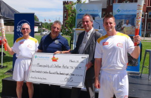 Chatham-Kent Mayor Randy Hope accepts a cheque from the OLG's Jake Pastore on behalf of the municipality (Photo by Jake Kislinsky)