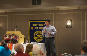 RCMP Constable Devon Jones speaks to the Rotary Club about identity theft June 8,2015 (BlackburnNews.com Photo by Briana Carnegie).