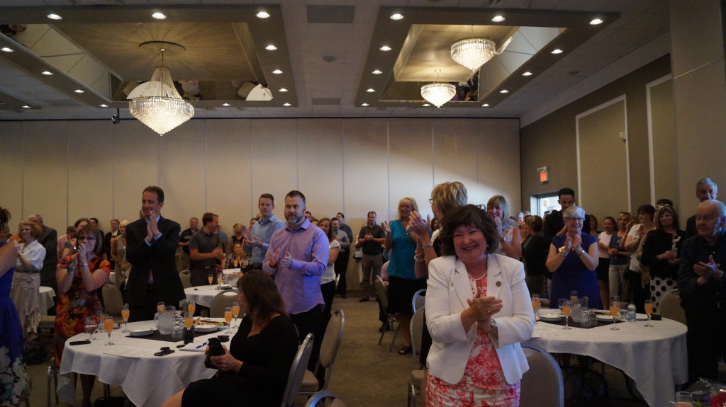 Lambton College President Judith Morris receives three standing ovations during her speech to large crowd gathered for Wednesday's announcement. June 24, 2015 (BlackburnNews.com Photo by Briana Carnegie)