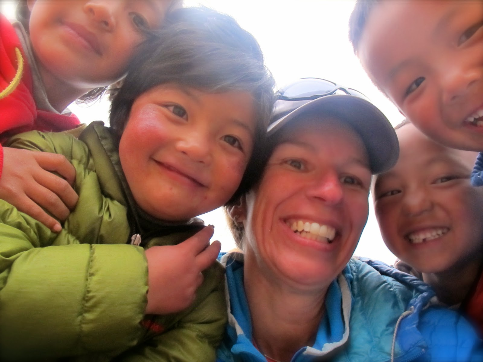Heather Geluk surrounded by children in Nepal. May 2015. (Photo courtesy of Heather Geluk)