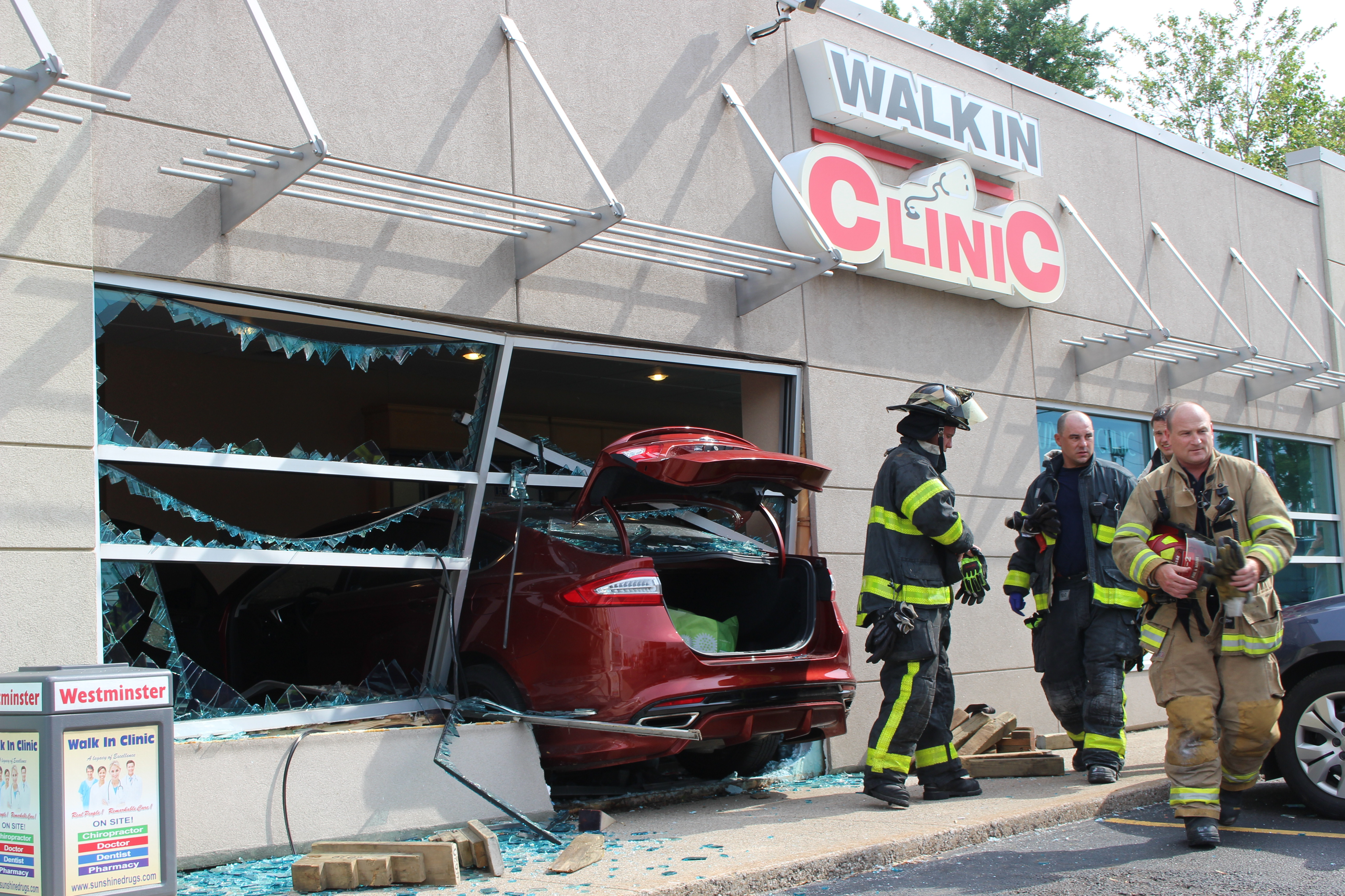 Emergency crews respond to a walk-in clinic on Tecumseh Rd. E after a car smashes through the front window, June 8, 2015. (Photo by Jason Viau)