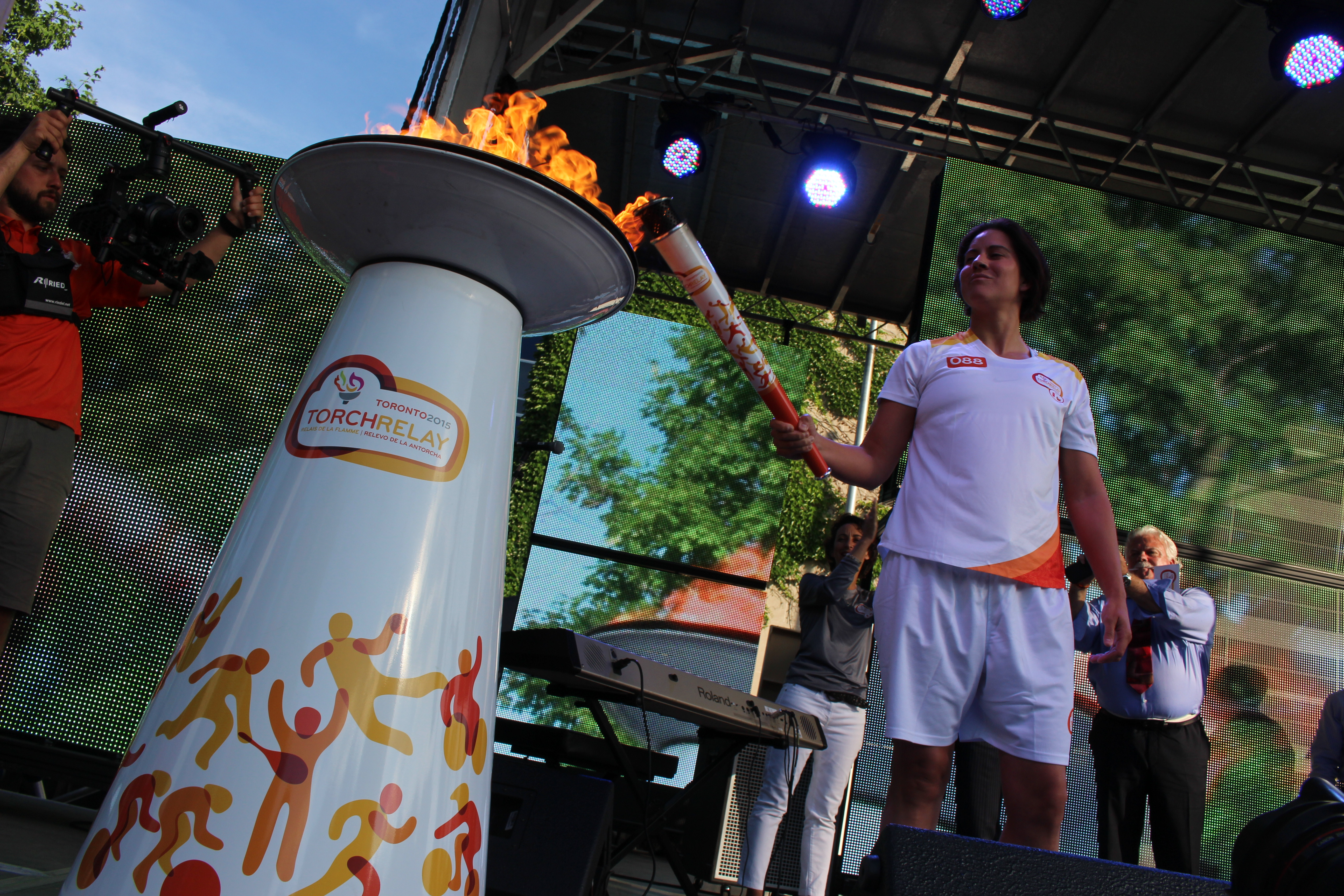 Olympic boxer Mary Spencer carries the flame during the Pan Am Torch Relay in Windsor, June 16, 2015. (Photo by Jason Viau)
