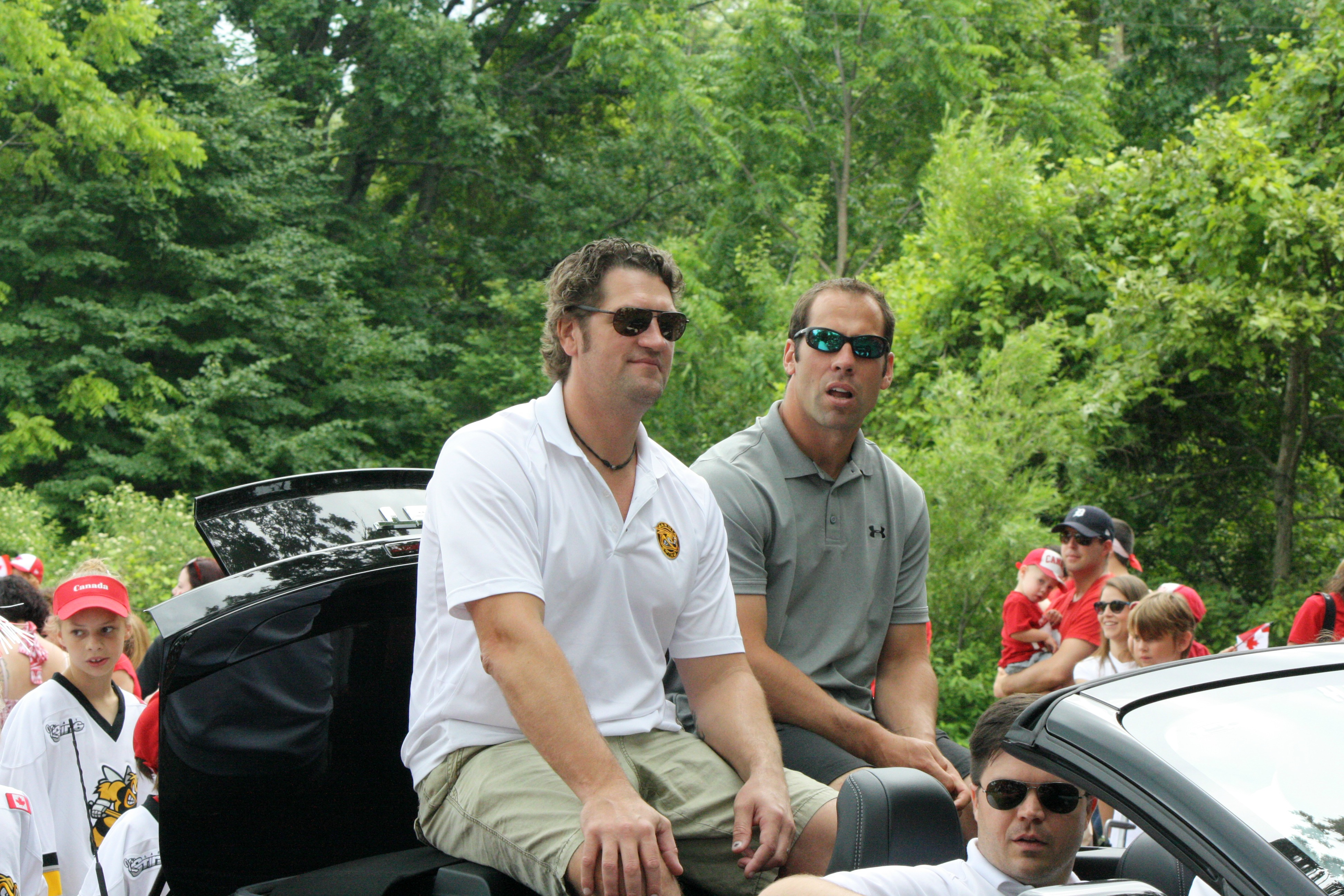 New Sting owners Derian Hatcher and David Legwand in Canada Day parade July 1, 2015 (BlackburnNews.com photo by Dave Dentinger)