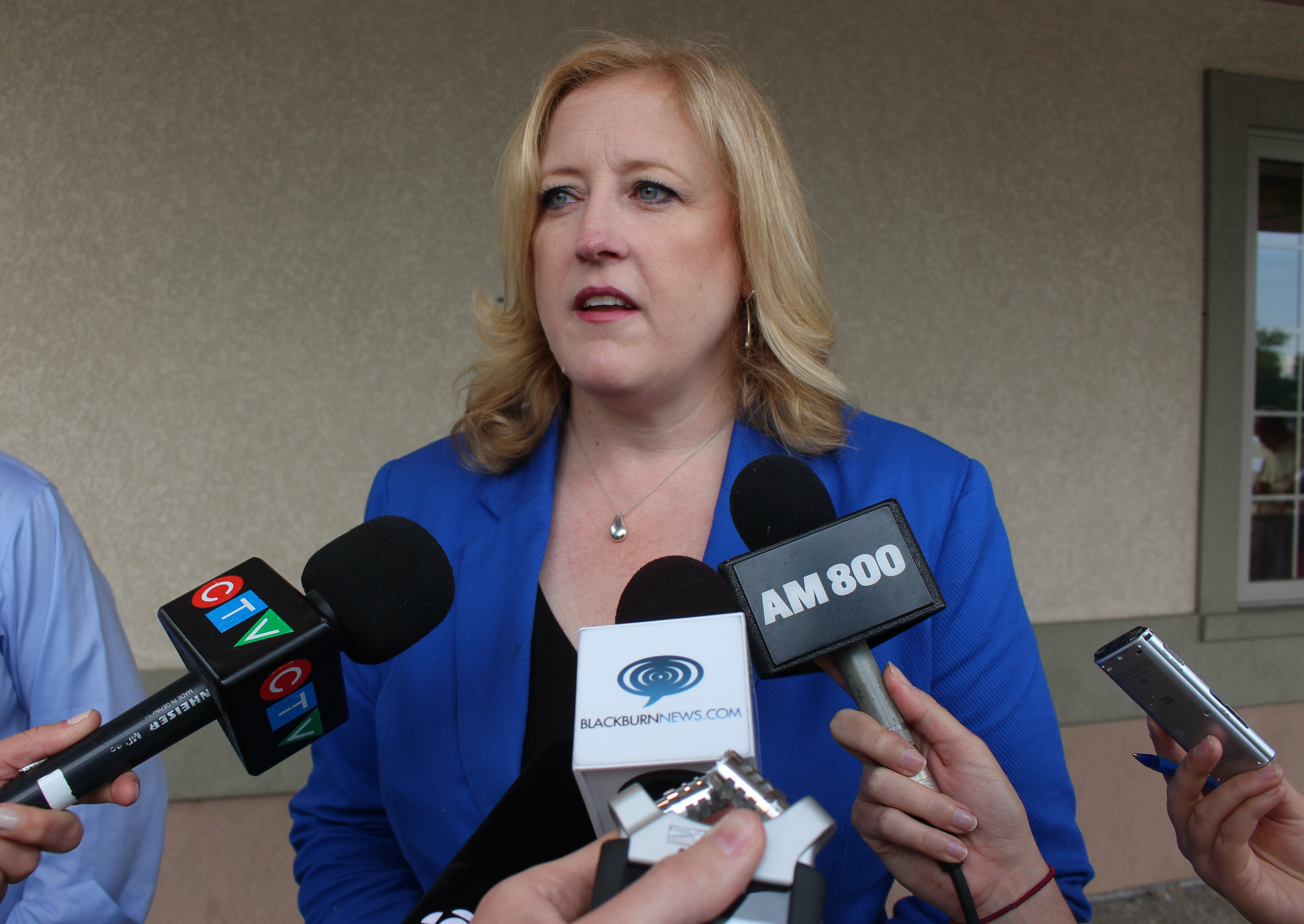 Federal Minister of Transport Lisa Raitt speaks at Windsors Fogolar Furlan Club, June 25, 2015. (Photo by Mike Vlasveld)