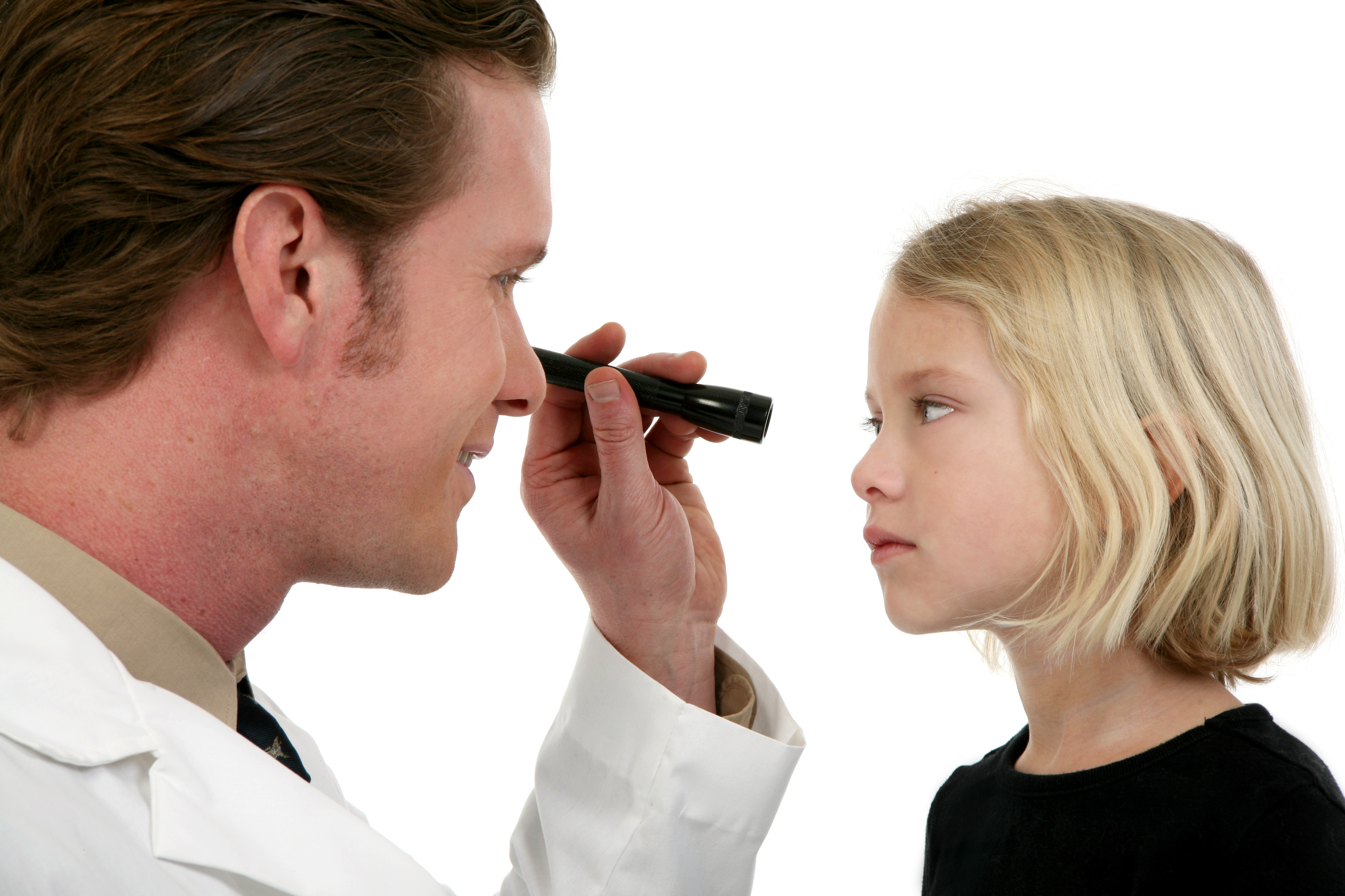 child getting an eye exam from Canstockphotos