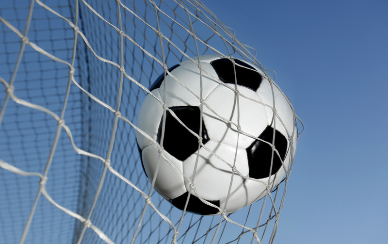 Soccer ball going into a net. © Can Stock Photo Inc. / mikdam