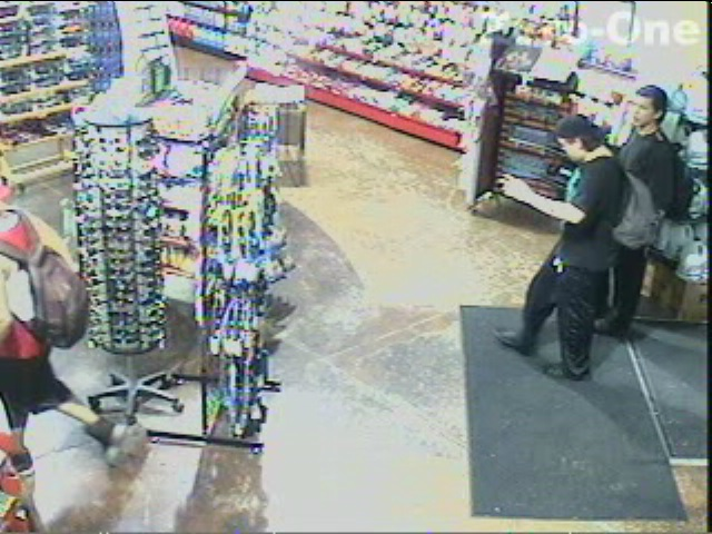 Two suspects wanted in connection with a robbery and assault at Q-Store on Dougall Ave., July 10, 2015. (Photo courtesy Windsor police)