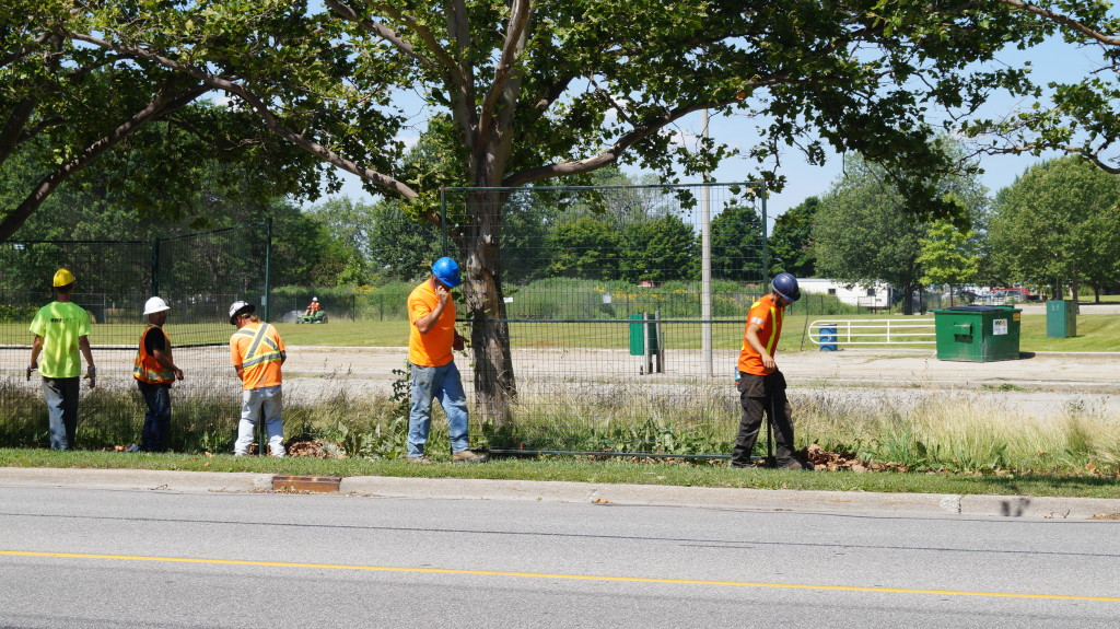 Centennial Park fencing comes down July 16, 2015 (BlackburnNews.com Photo by Briana Carnegie)
