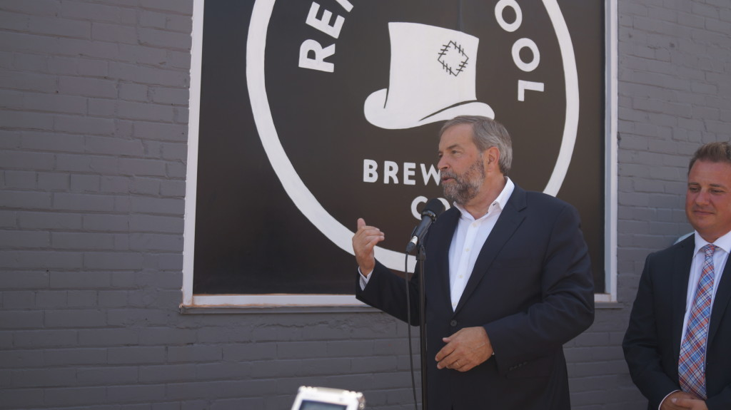 Federal NDP leader Tom Mulcair discusses tax rate cuts for small Canadian businesses at Refined Fool Brewery in Sarnia