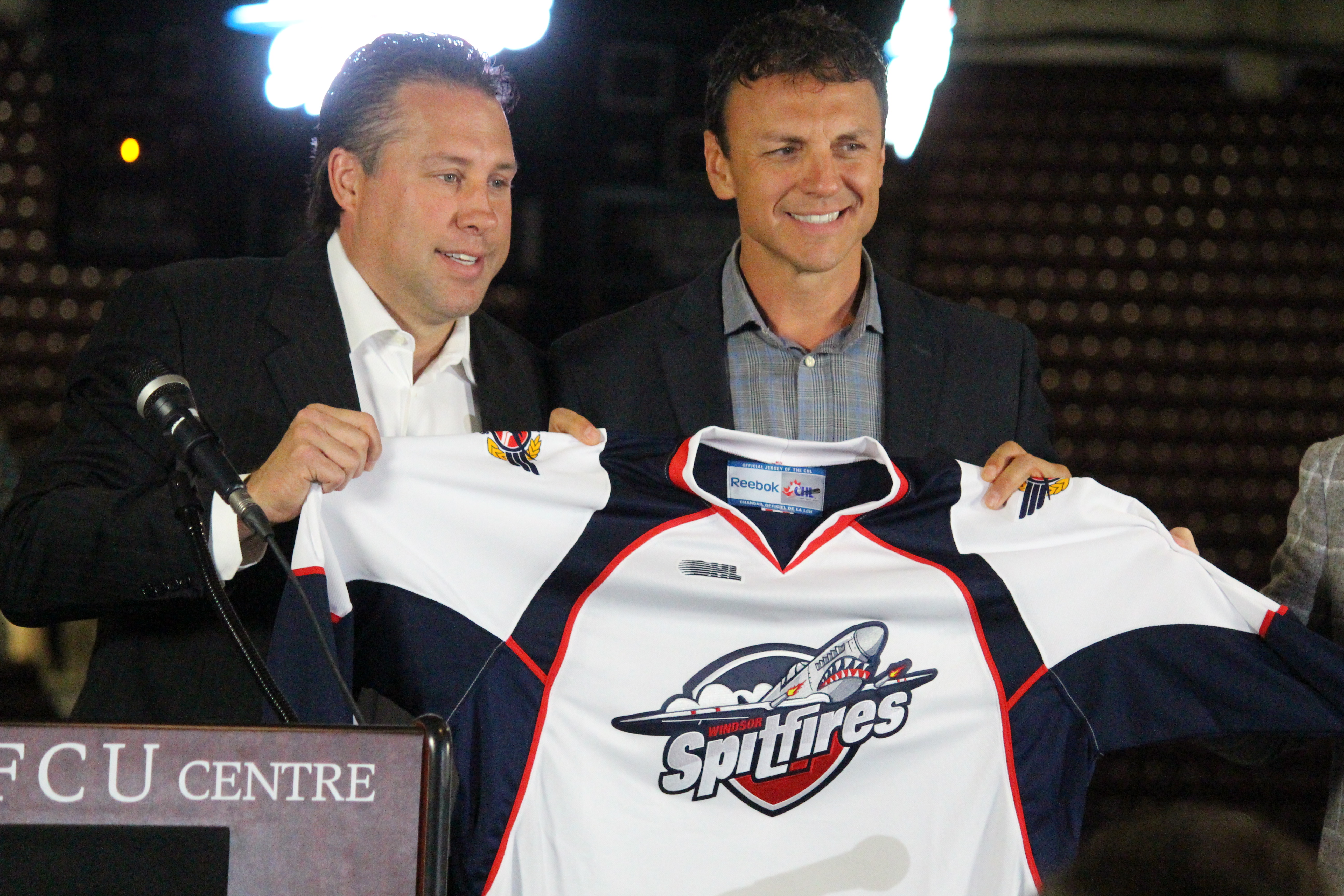 Windsor Spitfires Vice President and General Manager Warren Rychel announces Rocky Thompson as the team's new head coach, July 3, 2015. (Photo by Jason Viau)