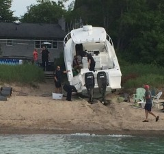 Police respond after a boat crashes into the shore near Canatara Park Beach, July 3, 2015. (Photo by Sue Storr)