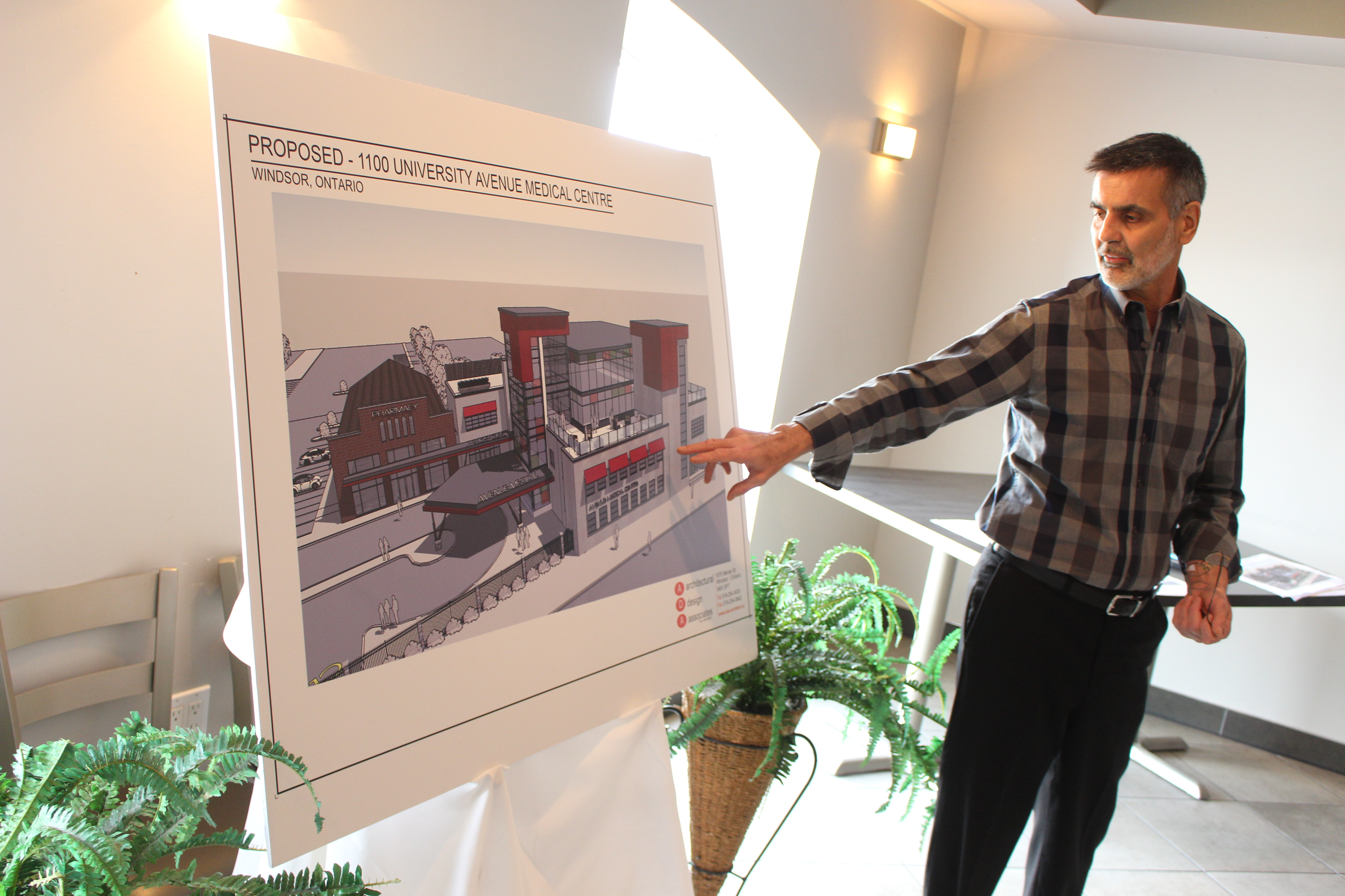 Site owner Van Niforos reveals plans to create a new medical centre at 1100 University Ave. W, July 14, 2015. (Photo by Jason Viau)