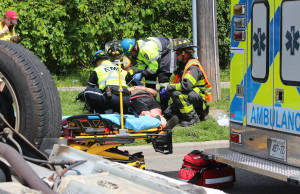 EMS crews tend to a number of people after a crash between a car and minivan at St. Luke Rd. and Richmond St., July 31, 2015. (Photo by Mike Vlasveld)