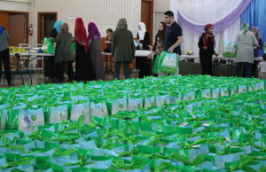 Members of the Windsor and Essex County Muslim community pack 1,500 bags full of food and toiletries for the ninth annual Spirit of Ramadan Food Drive, July 21, 2015. (Photo by Mike Vlasveld)