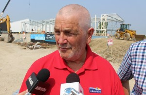 Lakeshore Mayor Tom Bain stands on the construction site, where his town's new aquatic centre is being built, July 6, 2015. (Photo by Mike Vlasveld)