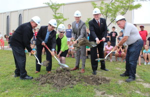 Four Windsor City Councillors, Windsor Mayor Drew Dilkens and a representative from DeAngelis Construction dig up ground where the new addition to the WFCU Centre will be built, July 7, 2015. (Photo by Mike Vlasveld)