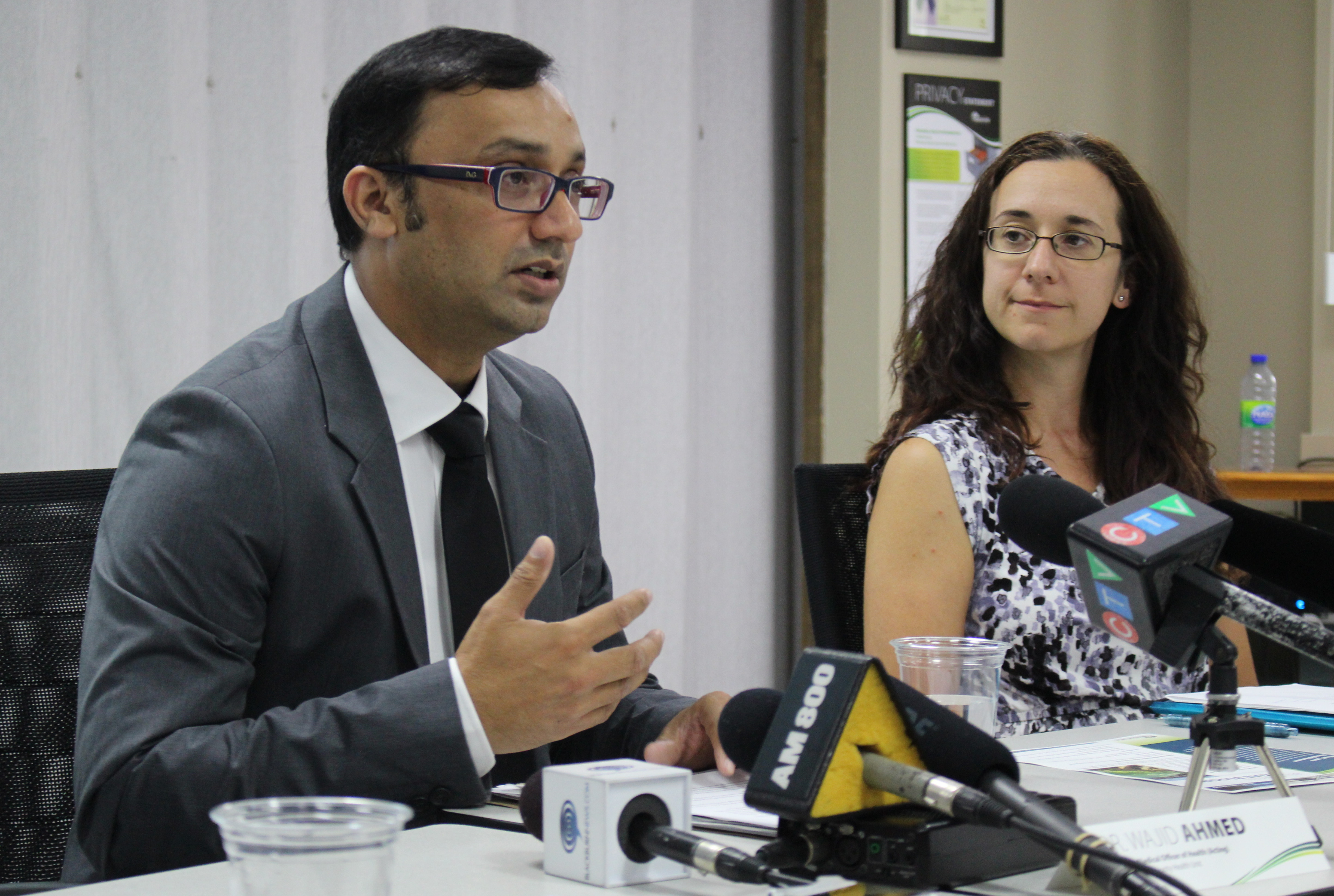 Medical Officer of Health Dr. Wajid Ahmed speaks, alongside Water Quality Scientist Katie Stammler, at the Windsor-Essex County Health Unit, July 24, 2015. (Photo by Mike Vlasveld)