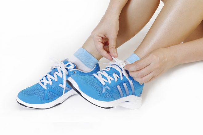 Girl tying running shoes. © Can Stock Photo Inc. / phloen