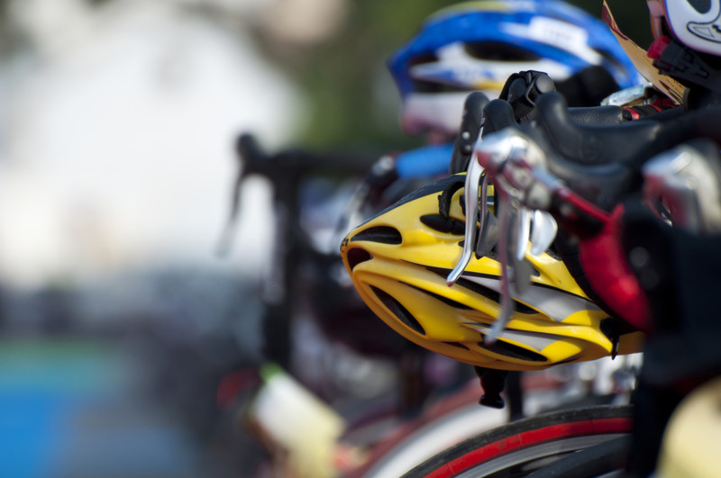 A cyclist helmet sitting on the bike waiting to be used at the transiation phase of the Triathlon. © Can Stock Photo Inc. / MrSegui