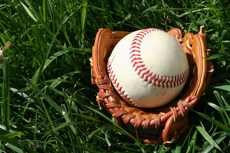 A baseball glove with a baseball. © Can Stock Photo Inc. / rmarmion