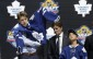 Mitch Marner puts on a Toronto Maple Leafs sweater after being chosen fourth overall during the first round of the NHL hockey draft, Friday, June 26, 2015, in Sunrise, Fla. The Maple Leafs have signed forward Marner to a three-year entry-level contract. THE CANADIAN PRESS/AP/Alan Diaz