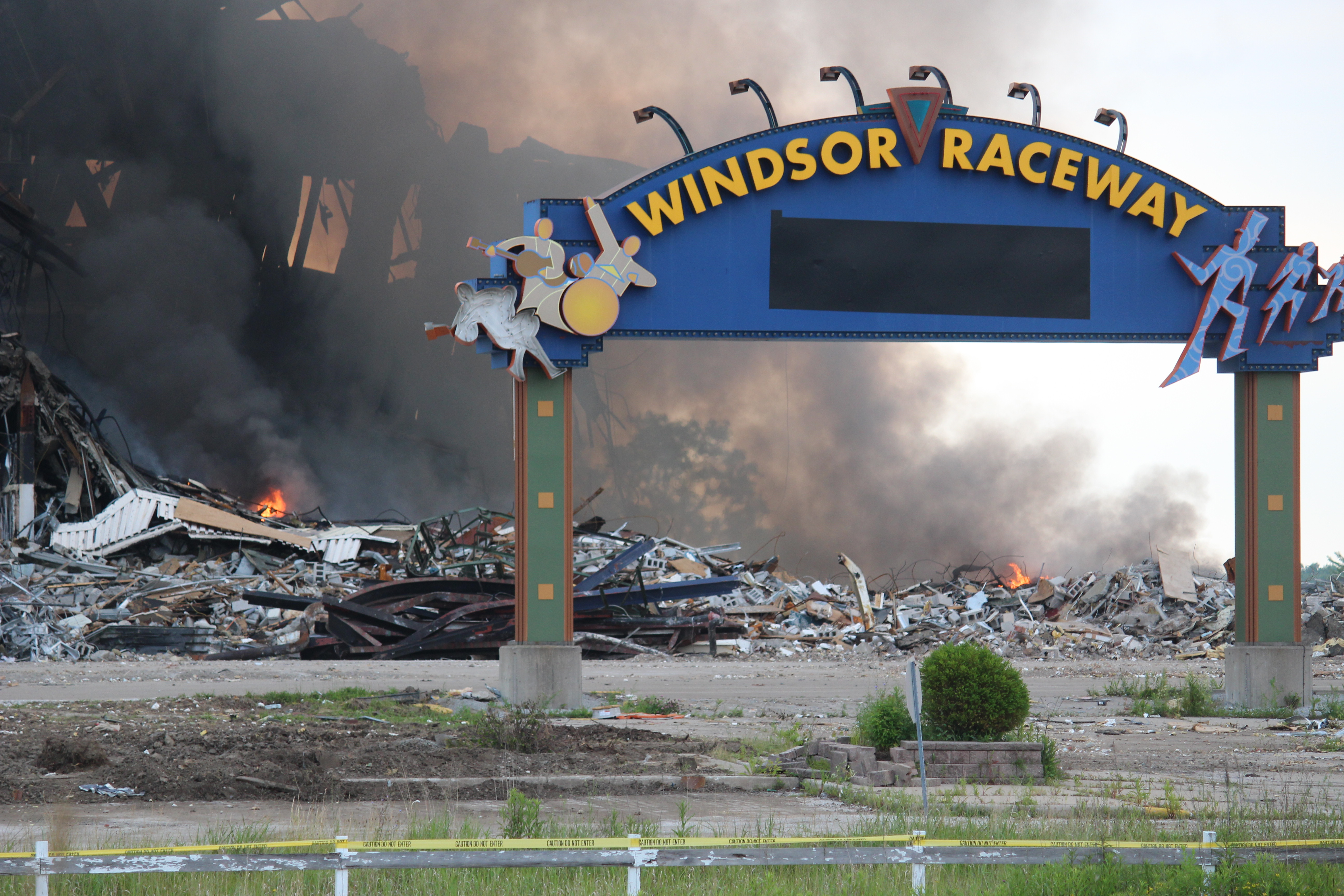 Fire smolders at Windsor Raceway July 1, 2015. (Photo by Adelle Loiselle)