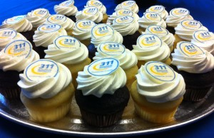 311 cupcakes are laid out at a news conference, celebrating the call centre's 10-year anniversary, August 27, 2015. (Photo by Mike Vlasveld)