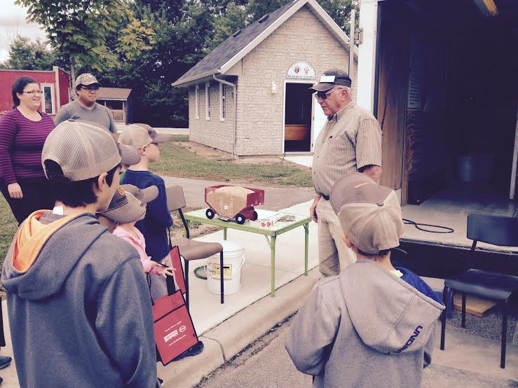 Children learning how quickly a grain bin can become a death trap Aug. 26, 2015. (Photo by Simon Crouch)