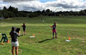 Kincardine's Brianna Cooper (lefto and holding tablet) helps young golfers as part of the Geared to Golf program. Submitted photo.