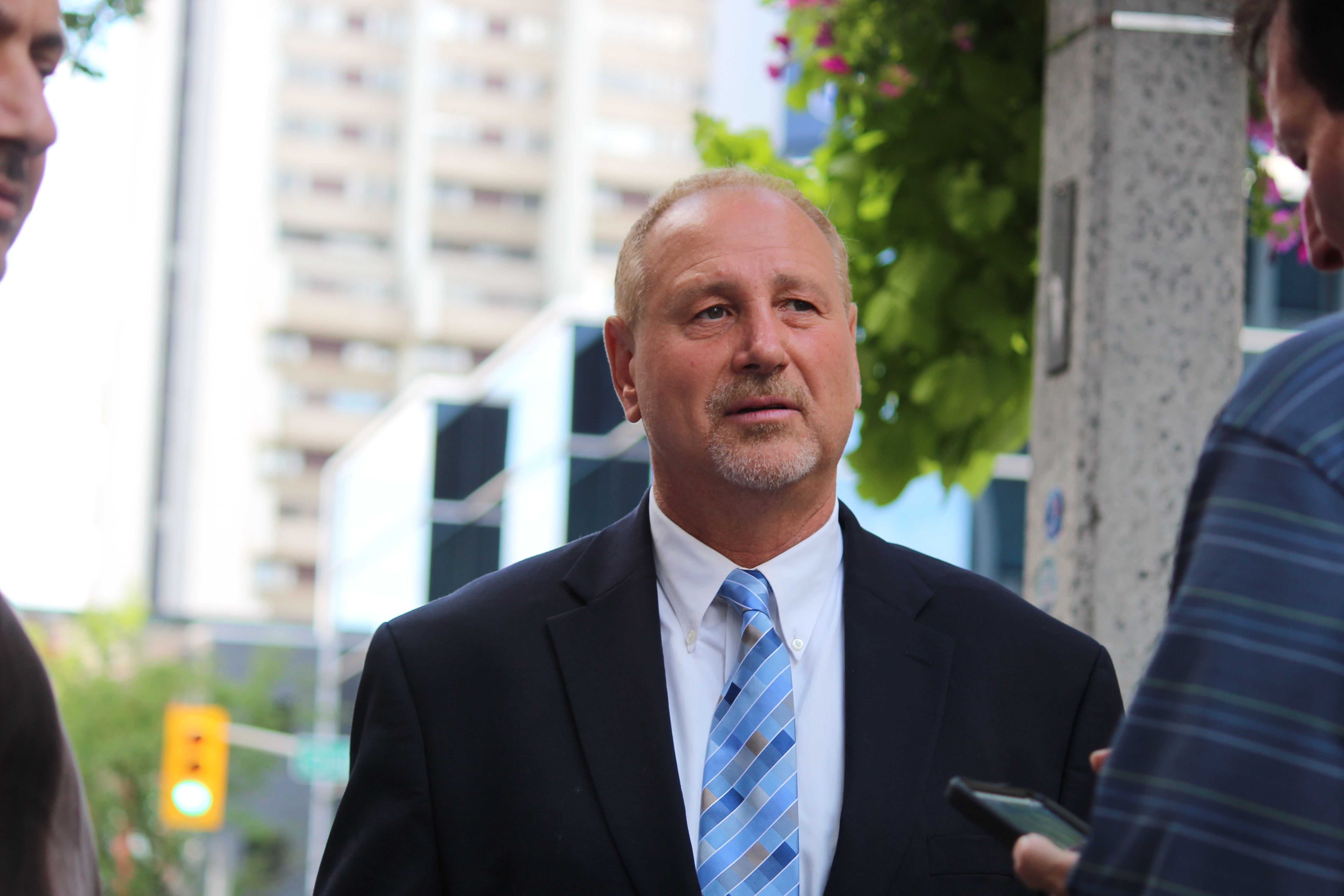 DWBIA Chair Larry Horwitz uses the backdrop of downtown Windsor to announce his bid to be the Conservative candidate in Windsor West on August 5, 2015. (Photo by Ricardo Veneza)