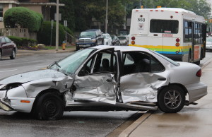 A car and a Transit Windsor bus collide at the intersection of Erie and Goyeau, August 10, 2015. (Photo by Jason Viau)