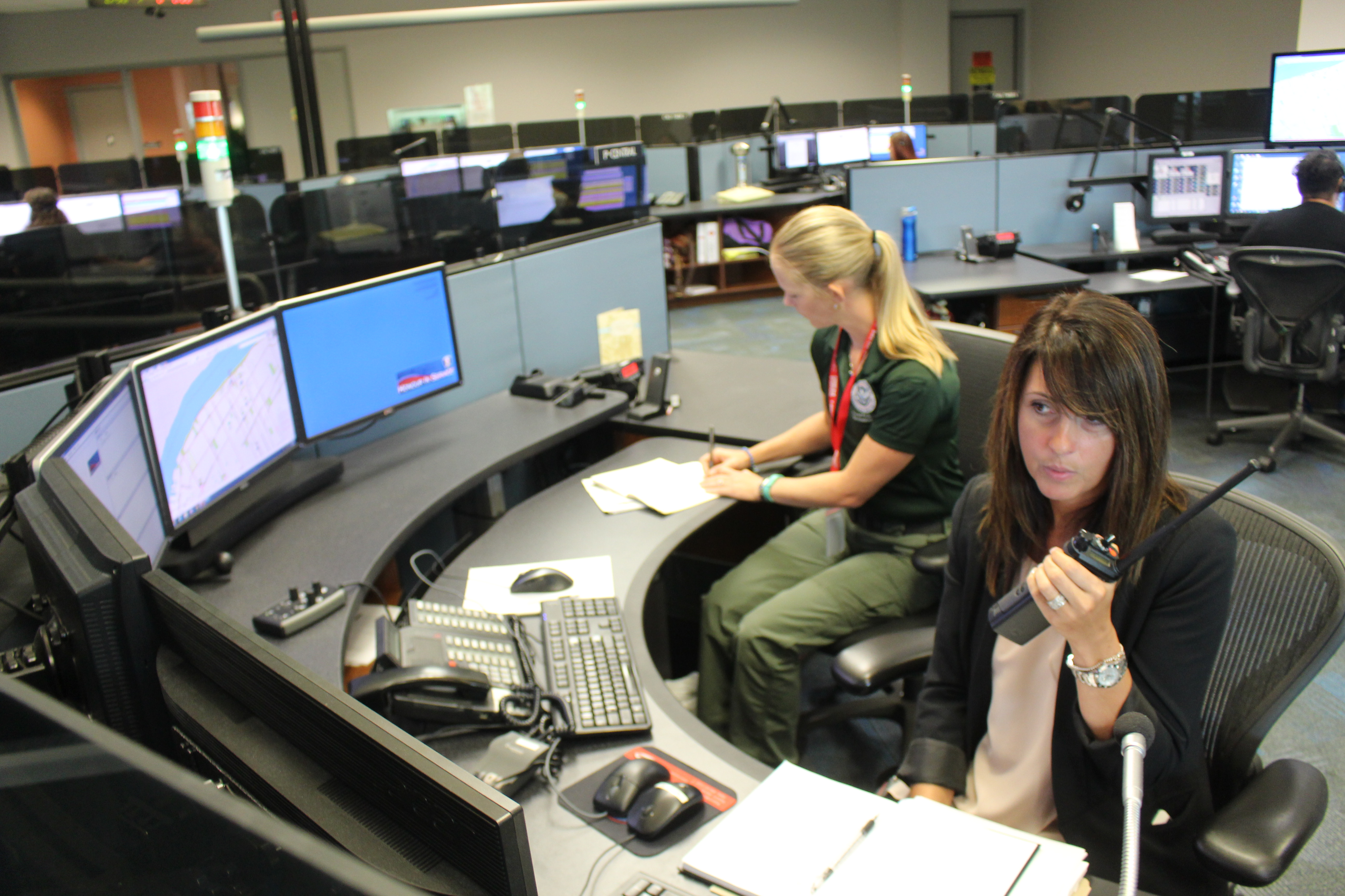 Officials with 911 dispatch in Windsor test new cross-border communication equipment, August 12, 2015. (Photo by Jason Viau)