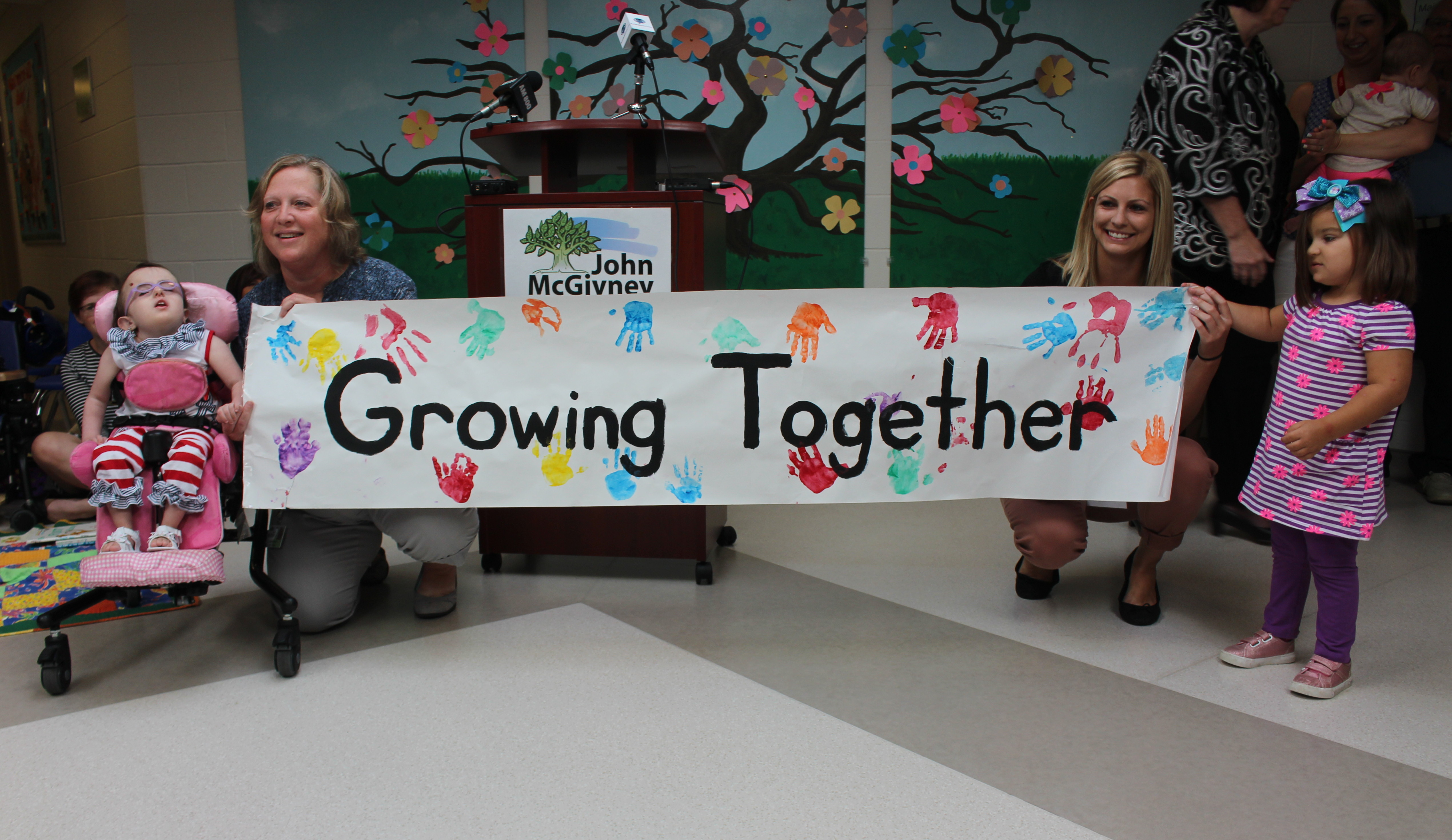 Staff members and kids at the John McGivney Children's Centre in Windsor help launch a newly redesigned program, August 20, 2015. (Photo by Mike Vlasveld)